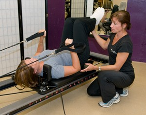 Gail Ericson working with a client at the Penny George Institute for Health and Healing's LiveWell Fitness Center