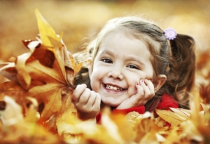 You don't have to spend a lot of money to find healthy, fun, family activities for the fall. Just raking the leaves can be a fun event for kids.